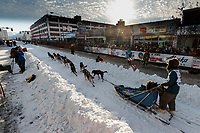 Lev Shvarts leaves the 4th avenue start line during the ceremonial start of the 2019 Iditarod in downtown Anchorage, Alaska on Saturday March 2.<br /> <br /> Photo by Jeff Schultz/  (C) 2019  ALL RIGHTS RESERVED