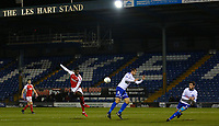Fleetwood Town's Jordy Hiwula (left) has a shot at goal despite the attentions of Bury's James Hansonduring the The Checkatrade Trophy match between Bury and Fleetwood Town at Gigg Lane, Bury, England on 9 January 2018. Photo by Juel Miah/PRiME Media Images.
