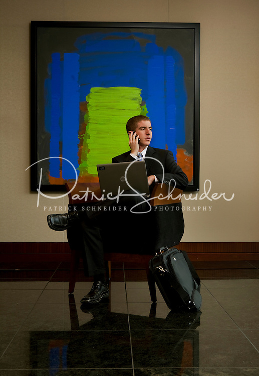 Young professional waits for a meeting in an upscale office building. Photographer has model release.