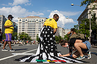 ZaK, the designer behind Jon Marc Collection, wears an American flag skirt, which was signed by protestersduring a march against police brutality and racism in Washington, D.C. on Saturday, June 6, 2020.<br /> Credit: Amanda Andrade-Rhoades / CNP/AdMedia