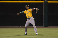 AZL Athletics left fielder George Bell (21) makes a throw to the infield during an Arizona League game against the AZL Giants Black at the San Francisco Giants Training Complex on June 19, 2018 in Scottsdale, Arizona. AZL Athletics defeated AZL Giants Black 8-3. (Zachary Lucy/Four Seam Images)