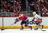 WASHINGTON, DC - JANUARY 31: Adam Pelech #3 of the New York Islanders trails T.J. Oshie #77 of the Washington Capitals during a game between New York Islanders and Washington Capitals at Capital One Arena on January 31, 2020 in Washington, DC.