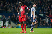 WEST BROMWICH, ENGLAND - FEBRUARY 11: Bafetibis Gomis of Swansea City  looks to the floor ager missing a shot on goal   during the Premier League match between West Bromwich Albion and Swansea City at The Hawthorns on February 11, 2015 in West Bromwich, England. (Photo by Athena Pictures/Getty Images)