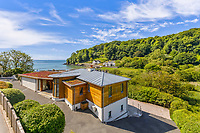 BNPS.co.uk (01202) 558833<br /> Pic: MarchandPetit/BNPS<br /> <br /> Pictured: The house and the view of the bay.<br /> <br /> A stunning contemporary home just a stone's throw from an idyllic beach is on the market for £3.85m.<br /> <br /> The aptly-named Beach House was designed to take advantage of its breath-taking views over North Sands Beach and out to sea.<br /> <br /> The four-bedroom oak-framed house is in a fantastic plot in one of the most sought after locations in Salcombe, Devon.<br /> <br /> As well as an expansive balcony to enjoy the views, it also has boat storage - a rarity in the town.