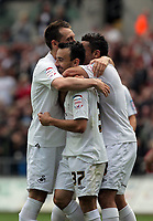 Pictured: Leon Britton of Swansea (C) celebrating his goal with teamates Stephen Dobbie (L) and Neil Taylor (R) making the score 4-0. Saturday 07 May 2011<br /> Re: Swansea City FC v Sheffield United, npower Championship at the Liberty Stadium, Swansea, south Wales.