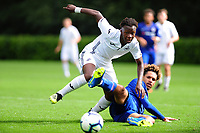 Tivonge Rushesha of Swansea City battles with Johnathon Russell of Chelsea FC during the Premier League u18 match between Swansea City AFC and Chelsea FC at Landore Training Ground, Wales, UK. Tuesday 11th September 2018