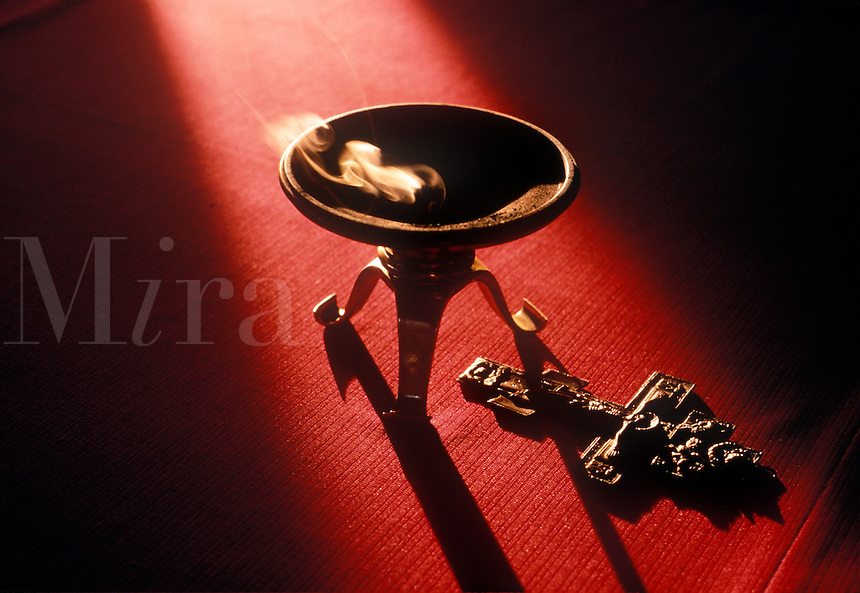 Burning incense and cross on alter during evening prayer at a catholic monastery.<br />