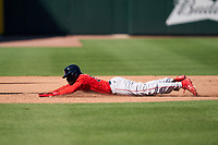 Boston Red Sox Marcus Wilson (53) slides head first into third base during a Major League Spring Training game against the Atlanta Braves on March 7, 2021 at CoolToday Park in North Port, Florida.  (Mike Janes/Four Seam Images)