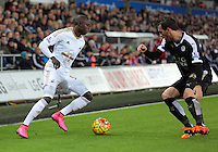 (L-R) Andre Ayew of Swansea against Danny Drinkwater of Leicester City  during the Barclays Premier League match between Swansea City and Leicester City at the Liberty Stadium, Swansea on December 05 2015