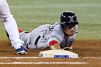 Boston Red Sox outfielder Scott Podsednik #26 dives back to first during an American League game against the Toronto Blue Jays at Rogers Centre on June 3, 2012 in Toronto, Ontario.  (Mike Janes/Four Seam Images)