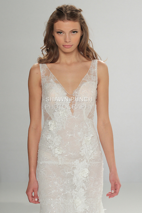 """Model walks runway in Ivy - an off white mermaid-cut hand embroidered lace dress with V-neckline, from the Tony Ward Fall 2016 """"A Mid-Summer Night's Dream"""" bridal collection on April 18, 2016 at Kleinfeld Bridal during New York Bridal Fashion Week Spring Summer 2016."""