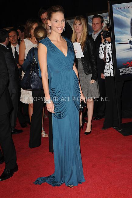 WWW.ACEPIXS.COM . . . . . ....October 20 2009, New York City....Actress Hilary Swank arriving at the premiere of 'Amelia' at the Paris Theatre on October 20 2009 in New York City....Please byline: KRISTIN CALLAHAN - ACEPIXS.COM.. . . . . . ..Ace Pictures, Inc:  ..tel: (212) 243 8787 or (646) 769 0430..e-mail: info@acepixs.com..web: http://www.acepixs.com