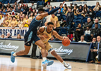 WASHINGTON, DC - FEBRUARY 8: Jameer Nelson Jr. #12 of George Washington dribbles by Cyril Langevine #10 of Rhode Island during a game between Rhode Island and George Washington at Charles E Smith Center on February 8, 2020 in Washington, DC.