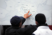 Pictured: Migrants look on a map of Europe pointing to FYRO Macedonia Monday 07 March 2016<br /> Re: Refugees at the Greek FYRO Macedonian border in Idomeni, Greece.