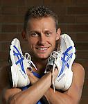 Modena, Stefano Baldini campione olimpionico maratona con le sue scarpe da corsa Olympic marathon champion Stefano Baldini with his running shoes.