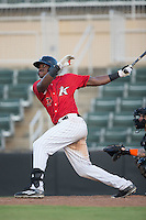 Micker Adolfo (37) of the Kannapolis Intimidators follows through on his swing against the Greensboro Grasshoppers at Intimidators Stadium on July 17, 2016 in Greensboro, North Carolina.  The Grasshoppers defeated the Intimidators 5-4 in game two of a double-header.  (Brian Westerholt/Four Seam Images)