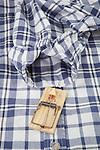 Mouse trap on men's flannel shirt, waiting patiently by opening.