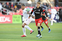 WASHINGTON, DC - MARCH 07: Roman Torres #29 of Inter Miami CF battles the ball with Julian Gressel #31 of D.C. United during a game between Inter Miami CF and D.C. United at Audi Field on March 07, 2020 in Washington, DC.