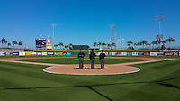 General view of the umpires standing at home plate for the national anthem before a game between the Cal State Fullerton Titans and Alabama State Hornets on February 14, 2015 at Bright House Field in Clearwater, Florida.  Alabama State defeated Cal State Fullerton 3-2.  (Mike Janes/Four Seam Images)
