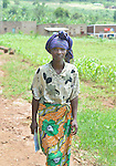 Community Health Worker Marie Chantal walking into her village,  Batamuliza Hururiro near Rukumo Health Center, Rwanda....