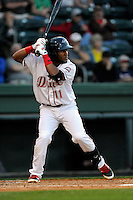 Infielder/second baseman Wendell Rijo (11) of the Greenville Drive bats in a game against the Kannapolis Intimidators on Thursday, April 10, 2014, at Fluor Field at the West End in Greenville, South Carolina. Rijo is the No. 18 prospect of the Boston Red Sox, according to Baseball America. Greenville won, 7-6. (Tom Priddy/Four Seam Images)