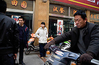 High-end businesses aimed at the Han community abutt the southern edge of the Old City in Kashgar, Xinjiang, China.
