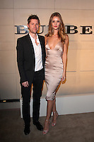 LOS ANGELES - OCT 26:  Chief Creative Officer of Burberry Christopher Bailey and actress Rosie Huntington-Whiteley arriving at the Burberry Body Launch at Burberry on October 26, 2011 in Beverly Hills, CA