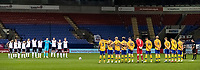 Both teams observe a minutes silence before the match<br /> <br /> Photographer Andrew Kearns/CameraSport<br /> <br /> The EFL Sky Bet League Two - Bolton Wanderers v Mansfield Town - Tuesday 3rd November 2020 - University of Bolton Stadium - Bolton<br /> <br /> World Copyright © 2020 CameraSport. All rights reserved. 43 Linden Ave. Countesthorpe. Leicester. England. LE8 5PG - Tel: +44 (0) 116 277 4147 - admin@camerasport.com - www.camerasport.com