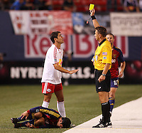 New York Red Bulls forward (9) Juan Pablo Angel draws a yellow card from referee Alex Prus for his hard tackle on Real Salt Lake forward (11) Alecko Eskandarian. The NY Red Bulls and Real Salt lake played to a 2-2 tie in an MLS regular season match at Giants Stadium, East Rutherford, NJ, on September 29, 2007.