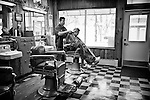 Black and white photo of haircut in the barbershop. Small business