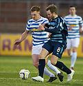 Morton's Ross Caldwell and Forfar's Gavin Malin challenge for the ball .