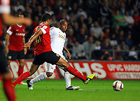 Pictured: Kemy Agustien of Swansea (R) against Jacob Mellis of Barnsley (L). Tuesday 28 August 2012<br /> Re: Capital One Cup game, Swansea City FC v Barnsley at the Liberty Stadium, south Wales.