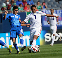 Cuba's Marcel Hernandez attempts to maneuver away from El Salvador's Jamie Alas.  El Salvador defeated Cuba 6-1 at the 2011 CONCACAF Gold Cup at Soldier Field in Chicago, IL on June 12, 2011.