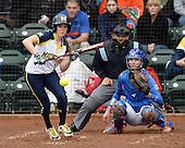 Michigan Wolverines outfielder Lyndsay Doyle (11) at bat in front of catcher Aubree Munro (1) and umpire Tyrone Miller during the teams season opener against the Florida Gators on February 8, 2014 at the USF Softball Stadium in Tampa, Florida.  Florida defeated Michigan 9-4 in extra innings.  (Mike Janes/Four Seam Images via AP Images)