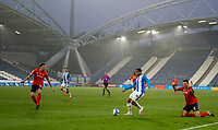 7th November 2020 The John Smiths Stadium, Huddersfield, Yorkshire, England; English Football League Championship Football, Huddersfield Town versus Luton Town; Matty Pearson of Luton Town pleads innocence as Josh Koroma of Huddersfield Town attacks in the penalty area and Glen Rea of Luton Town covers