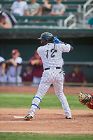 Juan Carlos Negret (12) of the Idaho Falls Chukars at bat against the Orem Owlz at Melaleuca Field on July 14, 2019 in Idaho Falls, Idaho. The Owlz defeated the Chukars 6-2. (Stephen Smith/Four Seam Images)