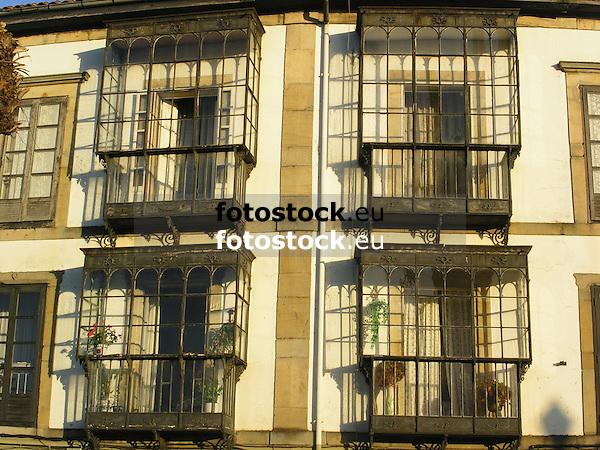 typical facade with windows protected of the wind and rain by glass balconies<br /> <br /> fachadas típicas de Asturias con ventanas protegidas del viento y la lluvia con balcones de vidrio<br /> <br /> typisch asturische Fassaden mit Fenster die durch gläsernde Balkone vor Wind und Regen geschützt werden