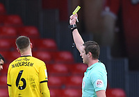 13th March 2021; Vitality Stadium, Bournemouth, Dorset, England; English Football League Championship Football, Bournemouth Athletic versus Barnsley; Mads Juel Andersen of Barnsley receives a yellow card from Referee John Brooks