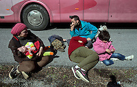 Pictured: A young family of migrants rest on the hard shoulder Thursday 25 February 2016<br />Re: Hundreds of migrants, including families with young children, that were stranded at Tempe in central Greece, were forced to walk on foot on the motorway to reach Idomen, about 168 kilometres away, in the northern part of the country, at the Greek FYRO Macedonian border. Local police were at first escorting them, then made sure that they were safely transported on coaches.