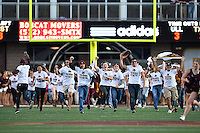 Texas State freshmen and fans take the field before NCAA football game kickoff, Tuesday, October 14, 2014 in San Marcos, Tex. Louisana Lafayette leads 21-3 at the halftime. (Mo Khursheed/TFV Media via AP Images)