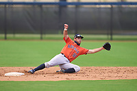 Houston Astros Cody Orr (85) dives for a throw during a Minor League Spring Training game against the Washington Nationals on April 27, 2021 at FITTEAM Ballpark of the Palm Beaches in Palm Beach, Fla.  (Mike Janes/Four Seam Images)