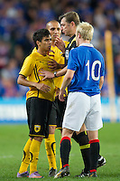 SYDNEY, AUSTRALIA - JULY 31, 2010: Leonardo Rodrigues Pereira of AEK Athens remonstrates with Steven Naismith of Rangers during the match between AEK Athens FC and Glasgow Rangers at the 2010 Sydney Festival of Football held at the Sydney Football Stadium on July 31, 2010 in Sydney, Australia. (Photo by Sydney Low / www.syd-low.com)