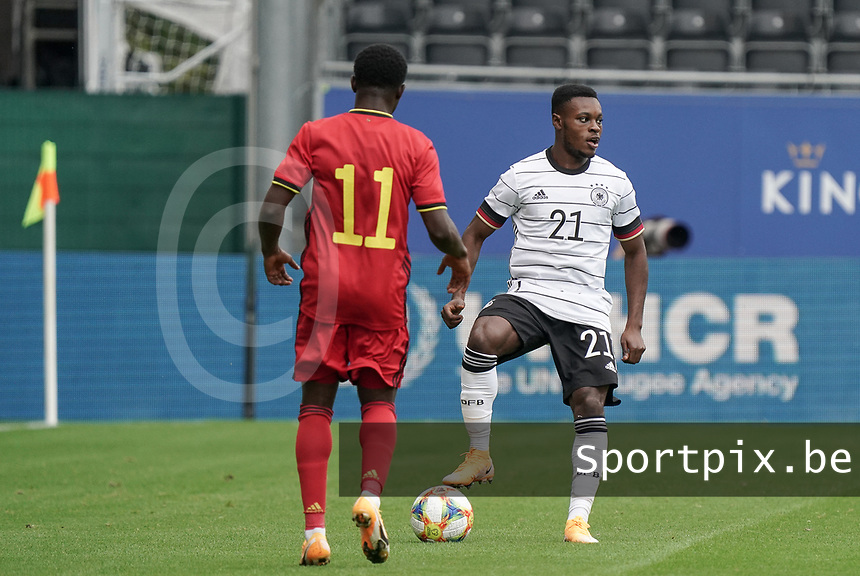 Belgium's Francis Amuzu (11) and Germany's Bote Baku (21) in action during a soccer game between the national teams Under21 Youth teams of Belgium and Germany on the 5th matday in group 9 for the qualification for the Under 21 EURO 2021 , on tuesday 8 th of September 2020  in Leuven , Belgium . PHOTO SPORTPIX.BE | SPP | SEVIL OKTEM