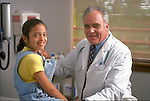 portrait of smiling young female patient with smiling elder doctor