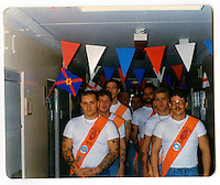 A photographs of Tommy and friends inside the Maze prison, each loyalist prisoners with his paper sash made for the July 12th celebration. 'The Twelfth' (also known as Orangemen's Day) which celebrates the 'Glorious Revolution' of 1688 (when Protestant king William III ascended the English throne) and the Battle of the Boyne (when William III defeated the catholic claimant James on the east coast of Ireland) is celebrated each year on the 12th of July. .