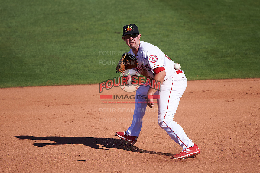 Mesa Solar Sox first baseman Eric Aguilera (24) fields a ground ball during an Arizona Fall League game against the Glendale Desert Dogs on October 14, 2015 at Sloan Park in Mesa, Arizona.  Glendale defeated Mesa 7-6.  (Mike Janes/Four Seam Images)