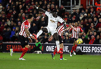 Pictured: Bafetimbi Gomis of Swansea heads the ball over James Ward Prowse of Southampton Sunday 01 February 2015<br />