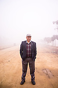 Dr. Rajesh Bathal (45), a doctor with WHO poses for a photograph while on a survey with his team at a construction site in Ghaziabad, Uttar Pradesh, India.