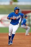 Samir Duenez #9 of the AZL Royals runs the bases during a game against the AZL Rangers at Surprise Stadium on July 15, 2013 in Surprise, Arizona. AZL Rangers defeated the AZL Royals, 3-2. (Larry Goren/Four Seam Images)
