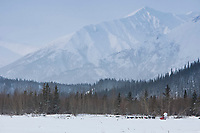 Art Church runs along the Tatina River with the Alaska Range in the background after coming through the Dalzell Gorge & 5 miles from the Rohn Checkpoint during the 2010 Iditarod